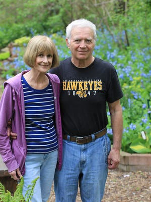 Liz Hall and Don Bolin pose for a photo in their garden behind their home on Monday, April 25, 2016.