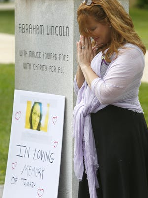 On the first anniversary of Tamara Wilson Sidle's death caused by her ex-husband and former Neptune Police Sergeant Philip Seidle, Patrice Lenowitz joins other people outside the Monmouth County Courthouse in Freehold Thursday , June 16, 2016, protesting how family courts there are operating.