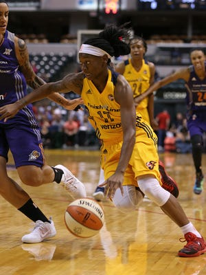 Indiana Fever guard Erica Wheeler (17) drives toward the basket during a  game against the Phoenix Mercury on Wednesday, May 18, 2016, at Banker's Life Fieldhouse.