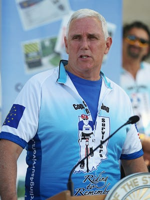 Gov. Mike Pence speaks before the start of the annual Cops Cycling for Survivors' 13-day ride across Indiana. Riders gathered Monday, July 11, 2016, at the Indiana State Museum in Downtown Indianapolis. Pence and his wife, Karen, rode the first leg.