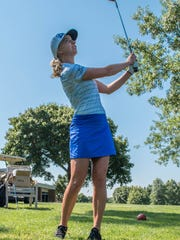 Sophia Popov from Germany works on chipping onto a