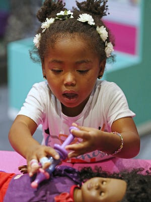 Ellie Jane Pfingston, 3, brushes up on her doctor skills in a new interactive Doc McStuffins exhibit based on the Disney television show, at the Children's Museum of Indianapolis, Sunday, August 7, 2016.