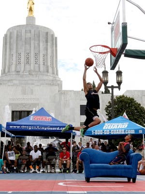 LJ Westbrook jumps over a couch to dunk at Hoopla in 2015.
