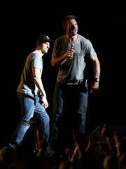 Dallas Clark and Ashton Kutcher entertain the crowd at the Back Porch Revival concert at Kinnick Stadium on Saturday, Aug. 27, 2016.