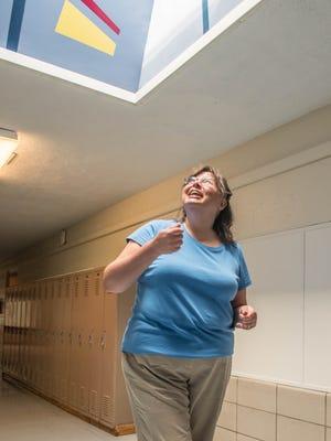 Harrington Elementary Principal Sandra Kingston looks up into one of the school's skylights.