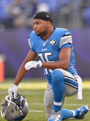 Detroit Lions wide receiver Golden Tate kneels on the field before a game against the Baltimore Ravens.
