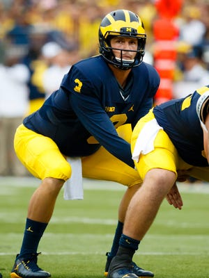 Michigan quarterback Wilton Speight gets set to run a play in the first quarter against the UCF Knights on Sept. 10, 2016, at Michigan Stadium.