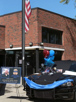 Balloons with messages on a police squad car that Detroit Police Department officers decorated to pay tribute to a Sgt. Kenneth Steil who was killed during a manhunt by decorating his squad car outside of the 9th Precinct on Monday, September 19, 2016.
