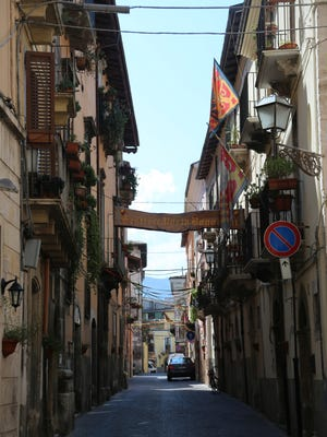 Sulmona is a quaint medieval city with cobblestone streets in the Abruzzo region of Italy.