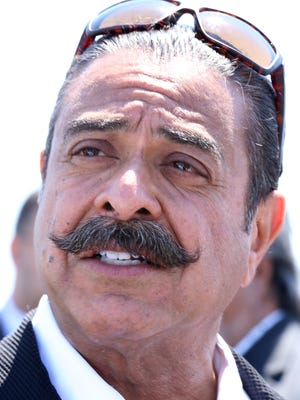 Shahid Khan, owner of Flex-N-Gate speaks during a press conference at a 30 acre site at the I-94 Industrial park area near the Detroit City airport,  where Khan, is proposing to build a facility to supply Ford vehicles and create up to 650 jobs on Wednesday, May 25, 2016.