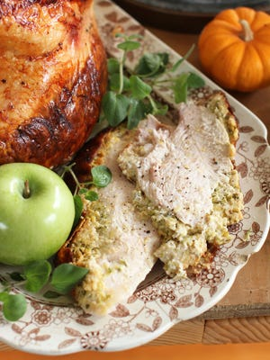 This file photo shows Italian-style roast turkey breast in Concord, N.H. If you're not feeding a crowd for the holidays, then roasting a turkey breast could be the way to go. This dish is from a recipe by Sara Moulton.