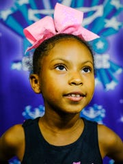 """What does 7-year-old McKenna Sanders wish for? A place to play. Her family used to live in Taylor, with two parks within walking distance of home. Now that she lives in Detroit, she says, """"I just wish there were more places to swim."""""""