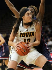 Iowa's Megan Gustafson drives to the hoop during the Hawkeyes' game against Robert Morris at Carver-Hawkeye Arena on Friday, Dec. 9, 2016.