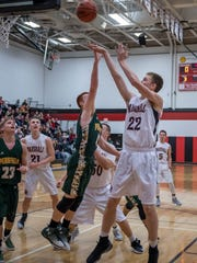 Marshall's Jeremy Luciani (22) goes for the hoop during
