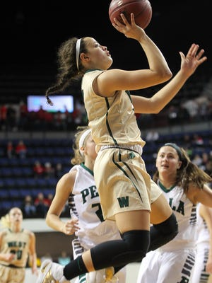 West High's Rachael Saunders goes up for a shot during the Women of Troy's game against Pella at the US Cellular Center in Cedar Rapids on Saturday, Jan. 7, 2017.