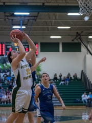 Pennfield's Alicia Lake (24) goes to the basket in