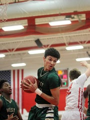 West High's Seybian Sims pulls in a rebound during