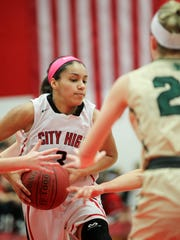 City High's Rose Marie Nkumu drives to the hoop during