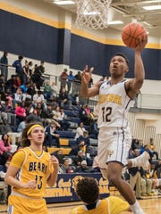 Battle Creek Central's Denzell Banks (12) goes for the basket during first half action against St. Joseph Tuesday evening.