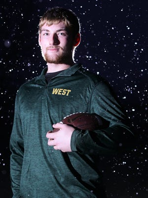 West High senior and Iowa State commit Alex Kleinow poses for a photo outside his home in North Liberty on Wednesday, Jan. 25, 2017.