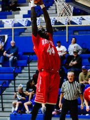 Nelson Mbongo soars high to slamhome two points for West Lafayette against Frankfort.