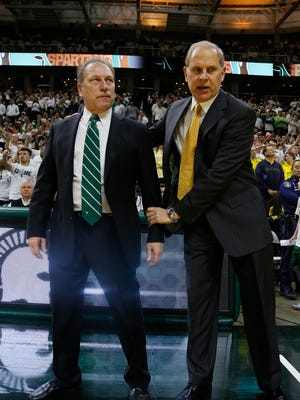 MSU coach Tom Izzo (left) checked in on Michigan coach John Beilein after his heart surgery.
