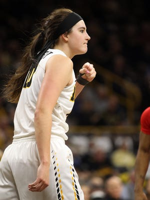 Iowa's Megan Gustafson celebrates after drawing a foul during the Hawkeyes' game against Rutgers at Carver-Hawkeye Arena on Thursday, Feb. 2, 2017.
