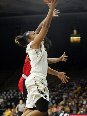 Iowa's Tania Davis goes up for a shot during the Hawkeyes' game against Rutgers at Carver-Hawkeye Arena on Thursday, Feb. 2, 2017.