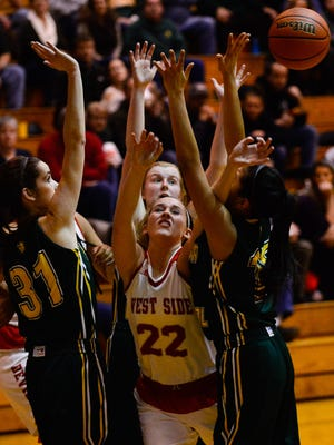 West Lafayette's Kylie Martin is swarmed by a gang of Benton Central defenders.