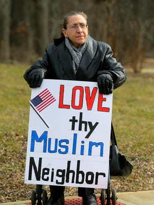Barbara Gonos of West Long Branch joins local residents as they gather with signs and later surround the Islamic Society of Monmouth County during its Friday prayers to show support for the Muslim community after the deadly shooting at a Quebec mosque and the Trump administration's refugee restriction order in Middletown, NJ Friday February 3, 2017.