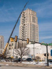 A crane lifts equipment to the top of the Heritage Tower Monday in downtown Battle Creek. 616 Development, which owns the building, said Sprint is installing new cell phone equipment on the roof.