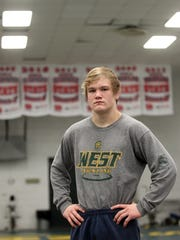 West High's Nelson Brands poses for a photo before