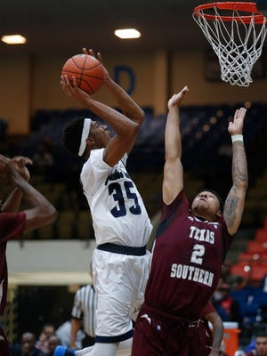 JSU forward Janarius Middleton shoots over TSU defender Zach Lofton during the Tigers' win Monday night at the Williams AAC in Jackson.