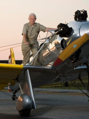 Branson tourism pioneer Mark Trimble with one of his favorite aircraft, a Ryan PT-22,  at the M. Graham Clark-Taney County Airport.