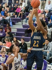 Battle Creek Central's Juan Warren goes for the 3-pointer during first half action against Lakeview Tuesday evening.