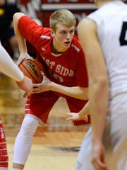 Luke Touloukian stares down an early possession in the championship of the boys basketball sectionals at Maconaquah