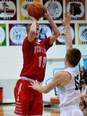 Luke Touloukian hits a jump shot early in the championship of the boys basketball sectionals at Maconaquah