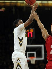 Iowa guard Isaiah Moss takes a 3-pointer during Wednesday's