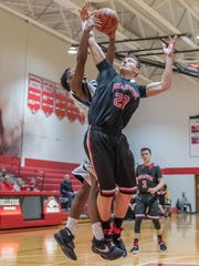 Bellevue's Carson Betz (23) goes for the hoop during first round action against Benton Harbor Dream Academy in regional tournament play Wednesday evening.