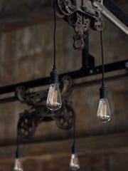 Lights hang down inside Rapid Creek Cidery at Wilson's