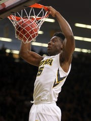 Iowa's Tyler Cook dunks the ball during the Hawkeyes' NIT second round game against TCU at Carver-Hawkeye Arena on Sunday, March 19, 2017.