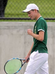 West High's Cole Schneider celebrates a point during the Trojans' meet against Linn-Mar on Tuesday, April 25, 2017.