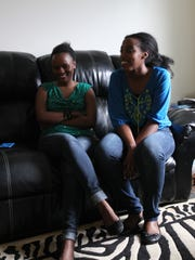 City High senior Aime'e Nyamadorai, left, and her friend, Cedar Rapids Jefferson senior Aime'e Nyandegeya look back at their time in the United States on Wednesday, May 17, 2017.