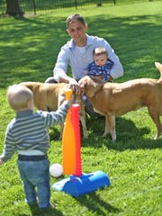 Dr. Adam Hill enjoys time at home with his family,