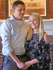 Dr. Adam Hill poses with his wife Lauren, Sunday, May