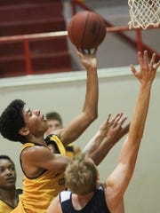Bettendorf's D.J. Carton goes up for a shot during