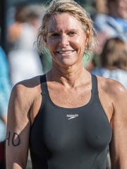 Jane Esahak-Gage is the 1st place female finisher for the 90th Annual Goguac Lake Swim on Saturday.