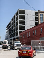 One 11 West is under construction at 111 Henry, just south of the arena and is photographed in Detroit on Monday, Aug. 21, 2017. It will contain ground-floor retail space and 80 new market-rate residences. It is attached to a new 500-space parking garage.