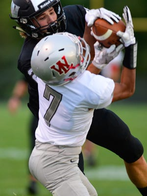 Kyle Hazell makes a key grab in the West Lafayette Red Devils vs. Western Panthers football game at Western High School.