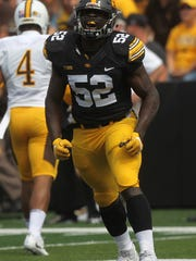 Iowa linebacker Amani Jones (52) celebrates a stop